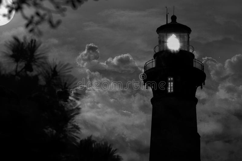 Lighthouse and full moon stock photography
