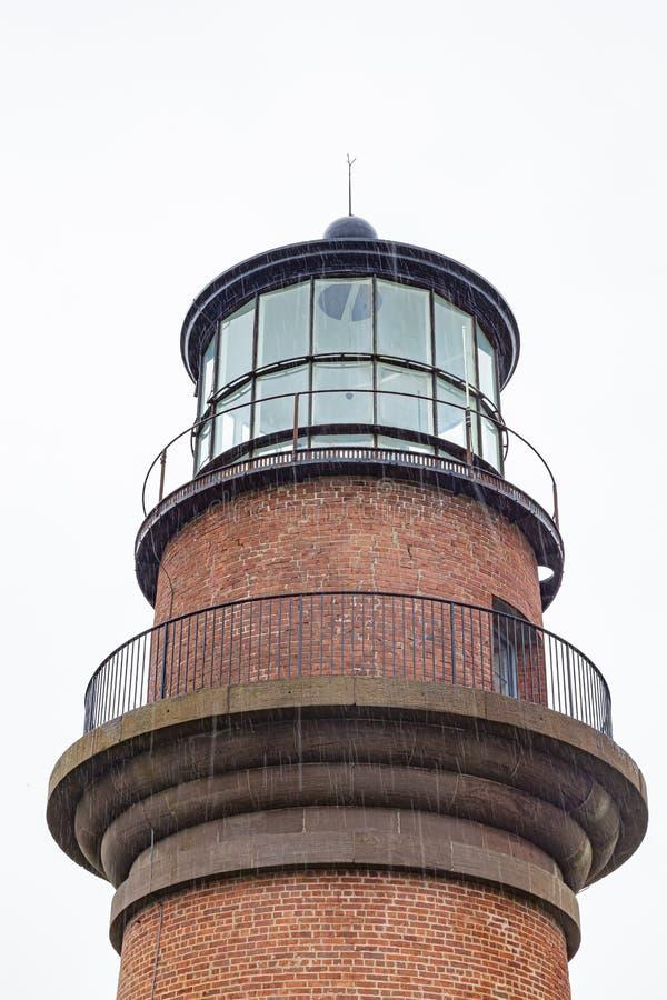 Lighthouse Gay Head Martha`s Vineyard with rain showers stock image