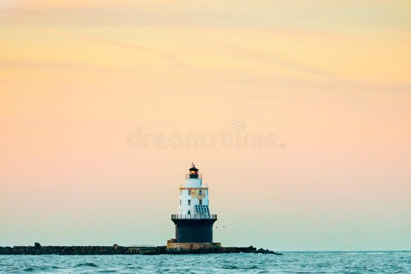 Lighthouse. Harbor of refuge lighthouse Delaware sunset sky stock image