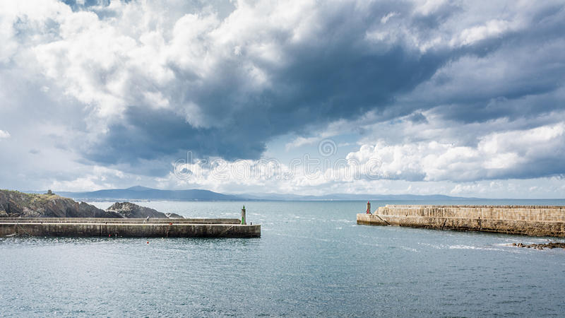 Lighthouse and harbor royalty free stock photography