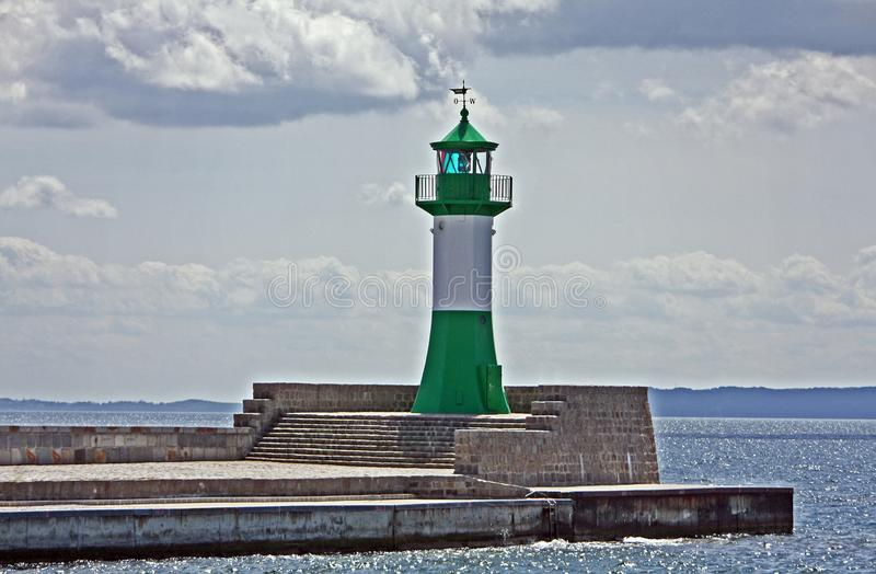 Lighthouse at the harbour entrance stock photos