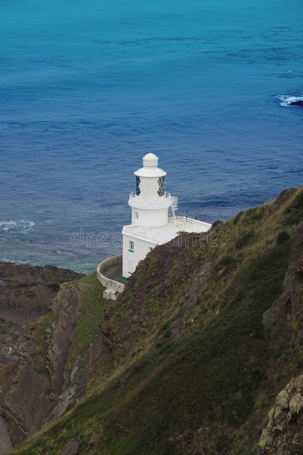 The lighthouse at Hartland Point. Hartland Point Lighthouse is a Grade II listed building at Hartland Point, Devon, England. The point marks the western limit of royalty free stock images