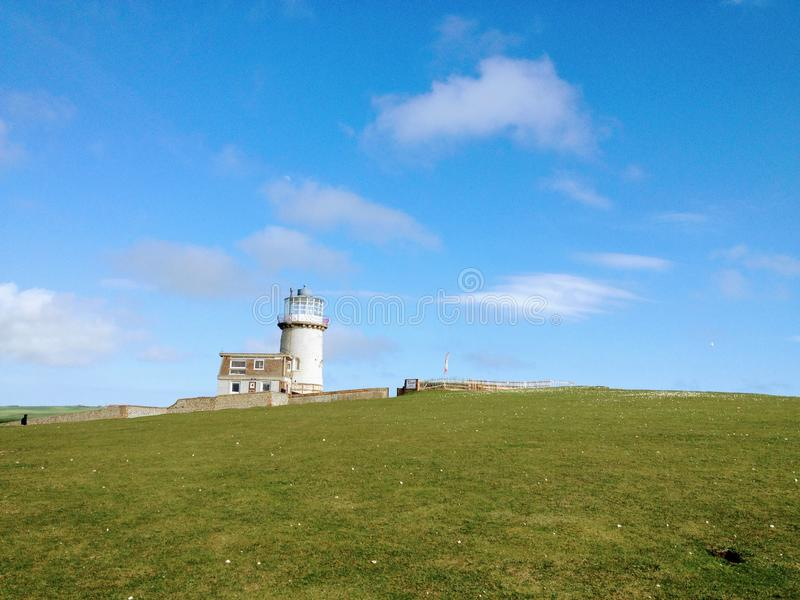 Lighthouse on the hill. The Belle Tout Lighthouse also spelled Belle Toute is a decommissioned lighthouse and British landmark located at Beachy Head, East royalty free stock images