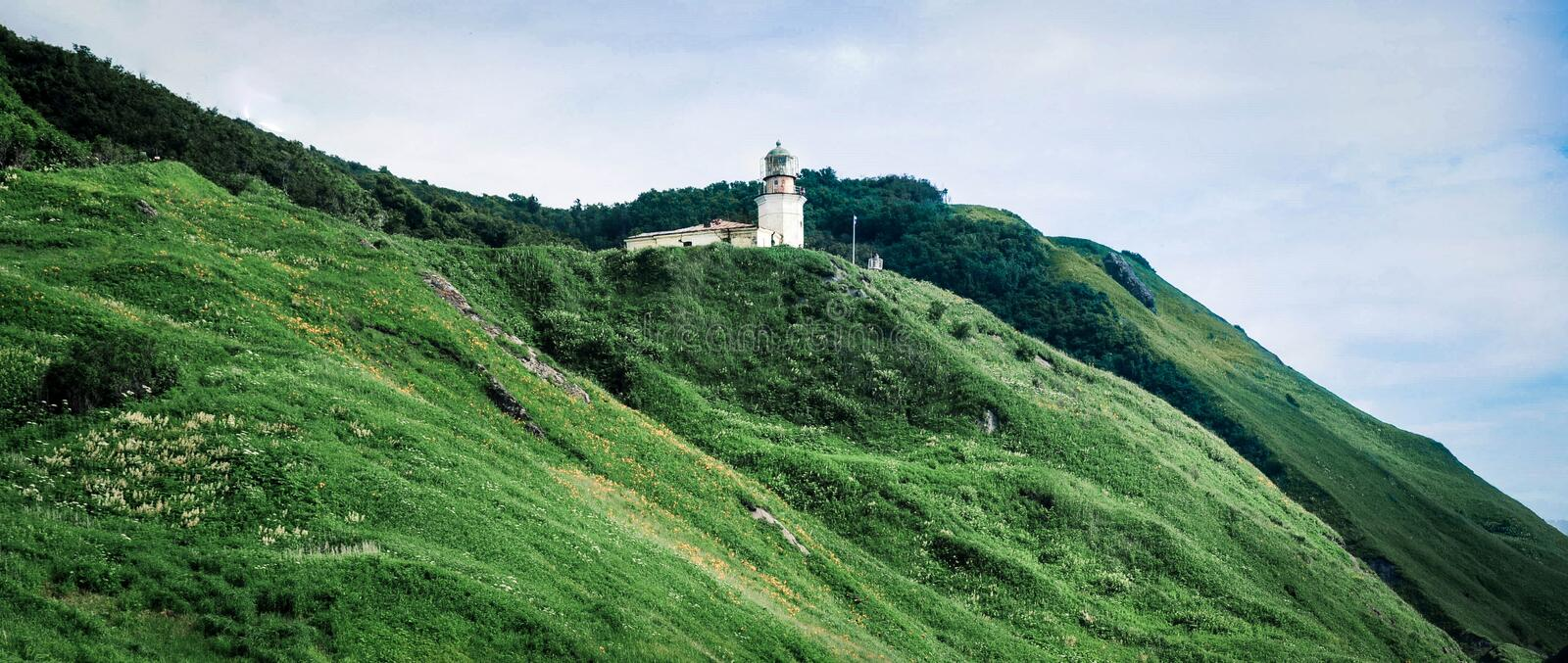 Lighthouse on the hills stock image