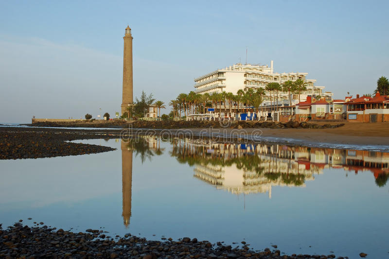 Lighthouse,hotels mirror in water-Gran Canaria. Lighthouse (El Faro) hotel and beach mirror in the water-Maspalomas-Gran Canaria-Europe stock images