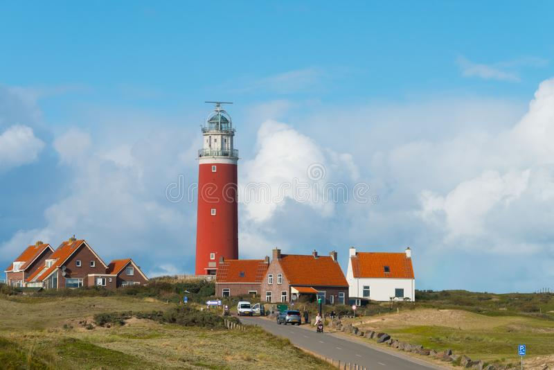 Lighthouse and houses of Texel stock photography