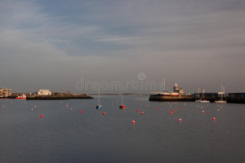 Lighthouse at Howth port. Howth is a fishing small port near Dublin Bay. royalty free stock photo