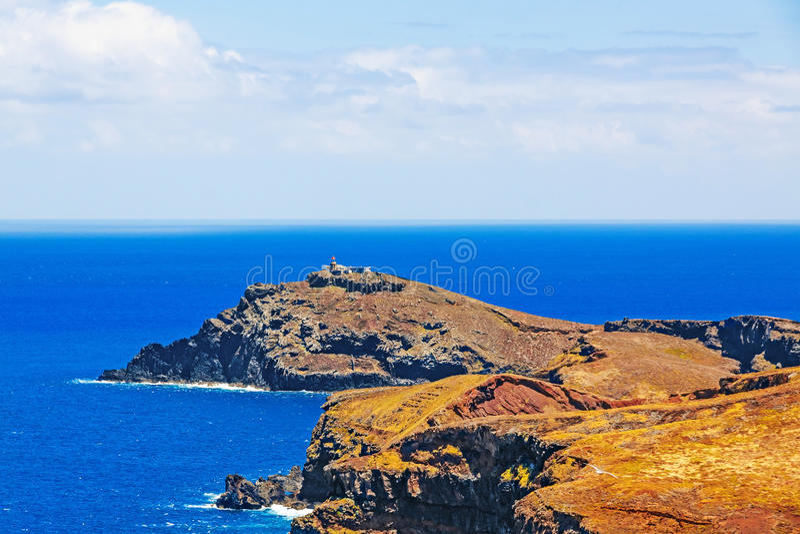 Lighthouse at Ilheu do Farol - the most easterly point on Madeira. Island Ilheu da Cevada / do Farol with lighthouse - the most easterly point on Madeira - view royalty free stock photos