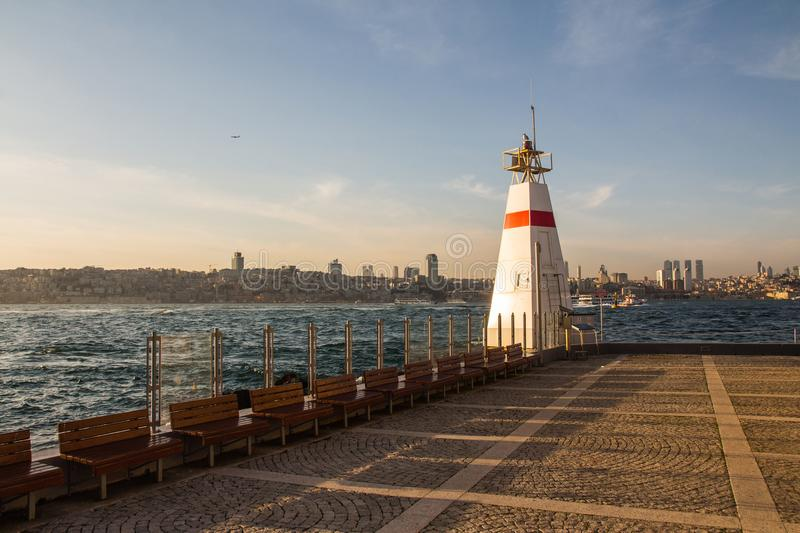 Lighthouse on the island near the `Maiden`s Tower` in the Bosphorus. Istanbul. Turkey.  royalty free stock images