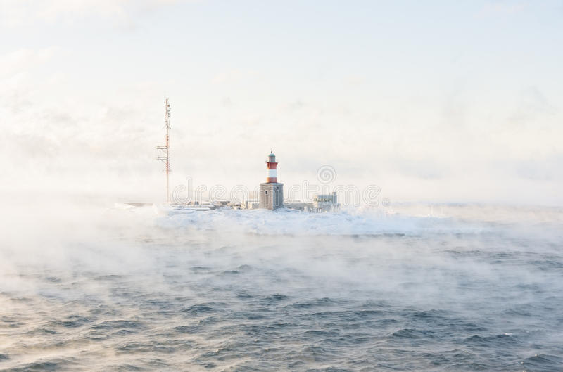 Download Lighthouse On An Isle In Misty Sea Stock Image - Image: 83703995