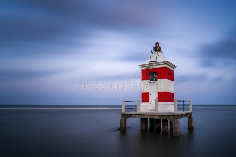 Lighthouse from Italy and long exposure water stock photo