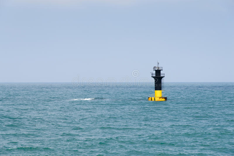 Lighthouse at the Jeju beach. Lighthouse alert for sunken rock near the Iho Teu Beach in Jeju Island, Korea stock photo