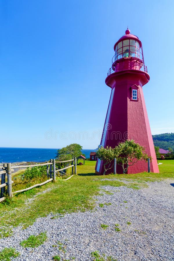 Lighthouse of La Martre, Gaspe Peninsula. View of the lighthouse of La Martre, Gaspe Peninsula, Quebec, Canada royalty free stock images