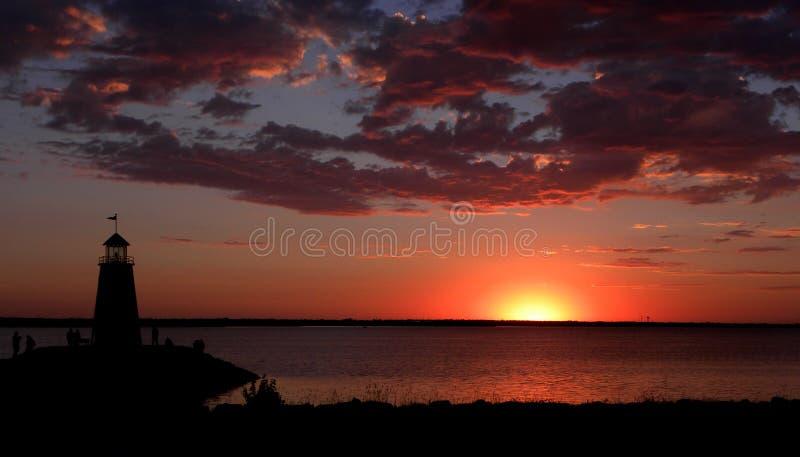 Lighthouse and Lake Sunset stock image