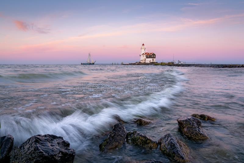 The Lighthouse. Sitting on top of my bucketlist for as long as I can remember... The Awesome lighthouse `Het Paard van Marken`. More a sunrise location but royalty free stock photo