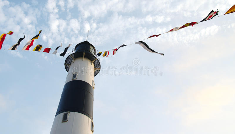 Lighthouse in Lima, Peru. Lighthouse with many signal flags on the coast of Lima in Miraflores, Peru royalty free stock photo