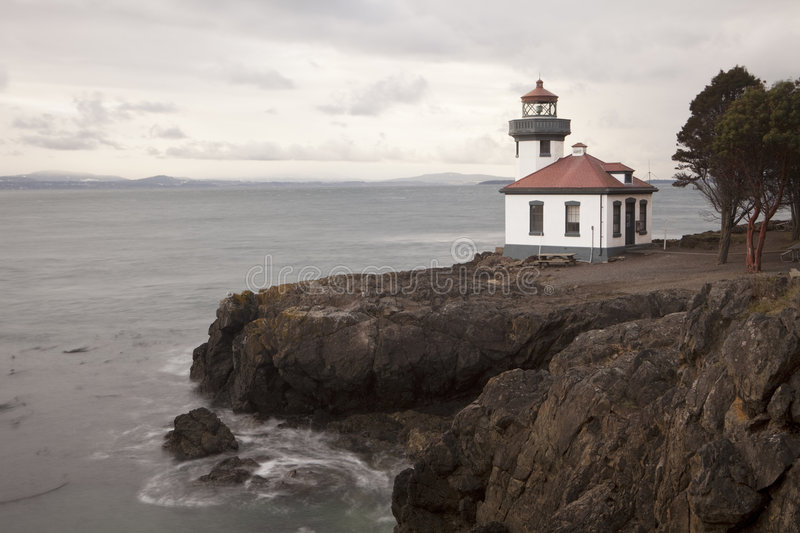 Lighthouse at Lime Kiln Point. The lighthouse at Lime Kiln Point State Park on San Juan Island. The building looks out over the waters of Puget Sound royalty free stock photo