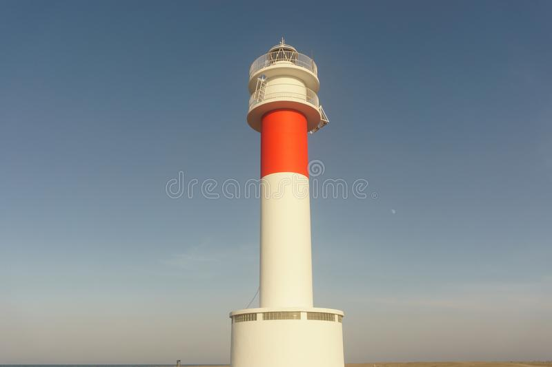 Close up of `Far del Fangar` lighthouse. Into Natural Park of Delta de l`ebre, Tarragona, Catalonia. Lighthouse located near a beach next to a desert in europe royalty free stock image
