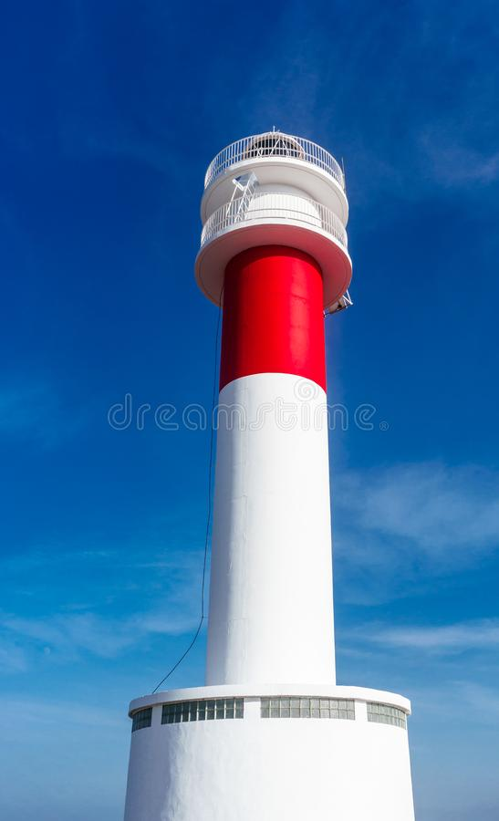 Close up of `Far del Fangar` lighthouse. Into Natural Park of Delta de l`ebre, Tarragona, Catalonia. Lighthouse located near a beach next to a desert in europe royalty free stock photography