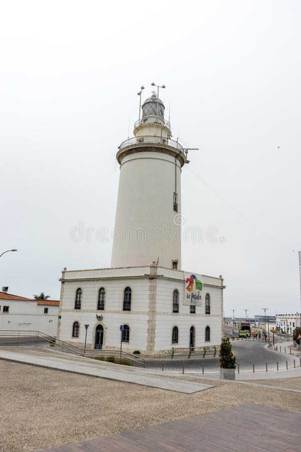 The lighthouse at Malagueta beach in Malaga, Spain, Europe. On a cloudy morning stock image