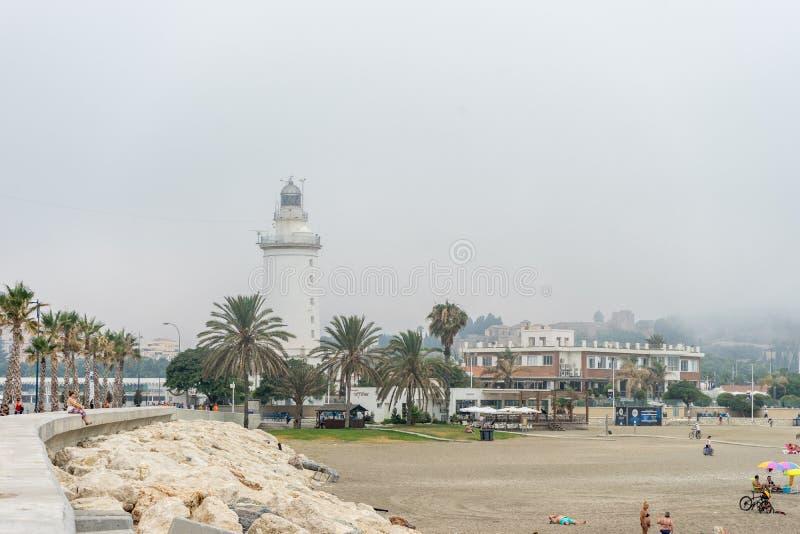 The lighthouse at Malagueta beach in Malaga, Spain, Europe. On a cloudy morning stock photos