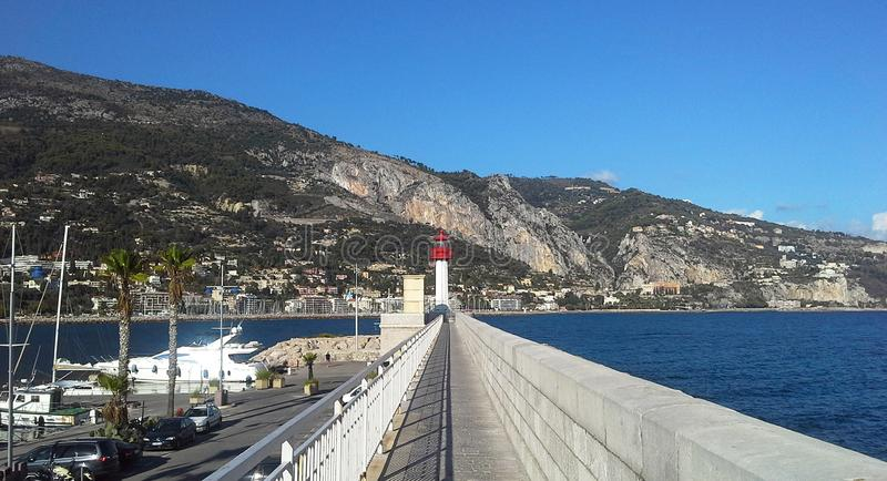 Lighthouse of Menton, a commune in the Alpes-Maritimes department in the Provence-Alpes-Cote of Azur region in southeastern France.  royalty free stock photography