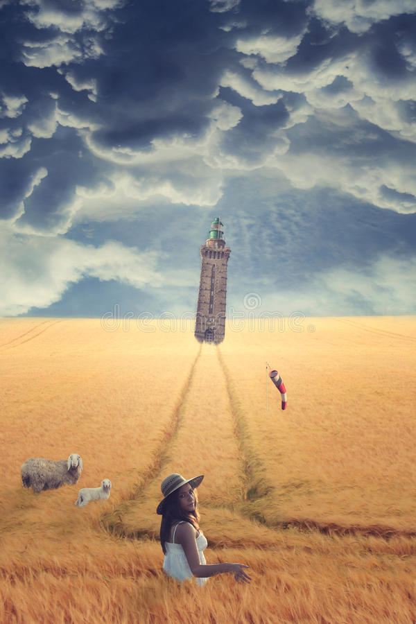 Lighthouse in the middle of strange field stock images