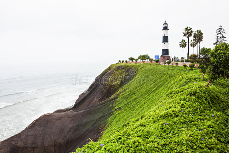 Lighthouse in Miraflores. La Marina Lighthouse (Faro la Marina) is a lighthouse in parkland on high cliffs above the Pacific Ocean, Miraflores district of Lima stock photography