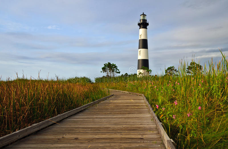 Lighthouse in the morning sun royalty free stock photography