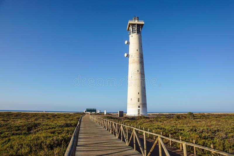 Lighthouse on Morro Jable beach on Jandia peninsula in sunrise light, Fuerteventura, Canary Islands, Spain.  stock photography