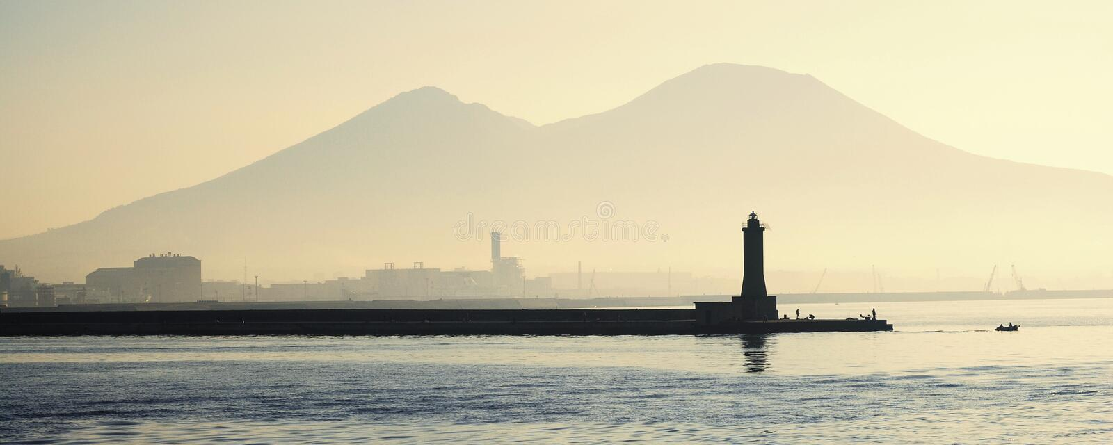Lighthouse with Mount Vesuvius stock image