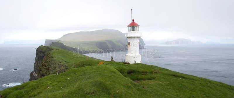 Lighthouse on Mykines Holmur stock image