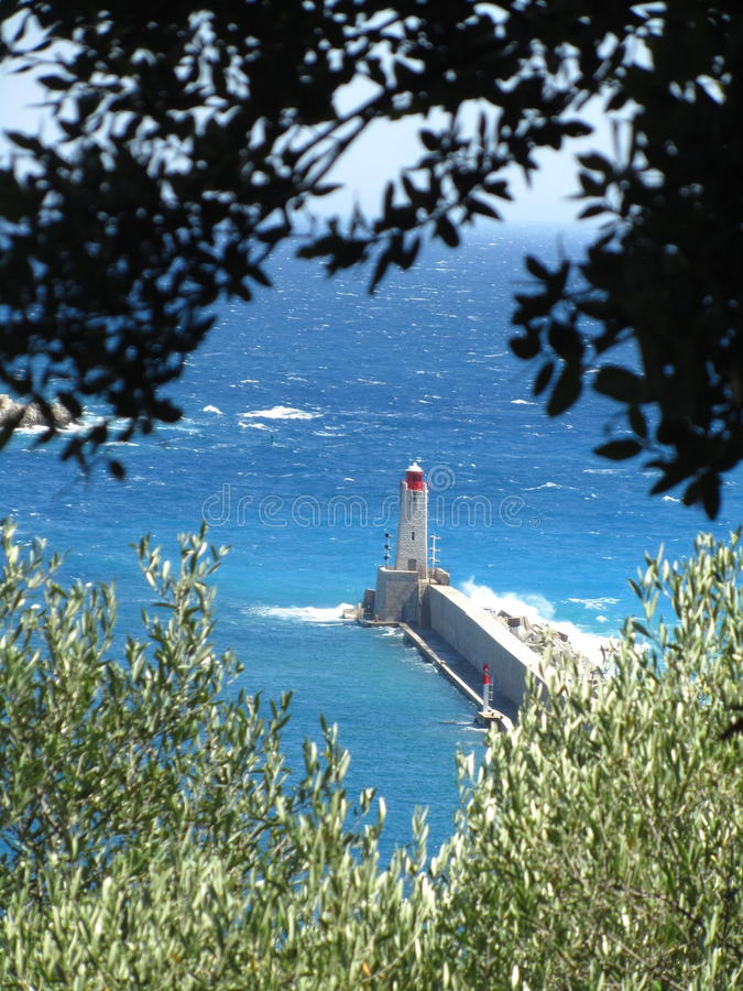 Lighthouse in Nice. View of the Lighthouse at the old port of Nice, France Côte d`Azur stock photos