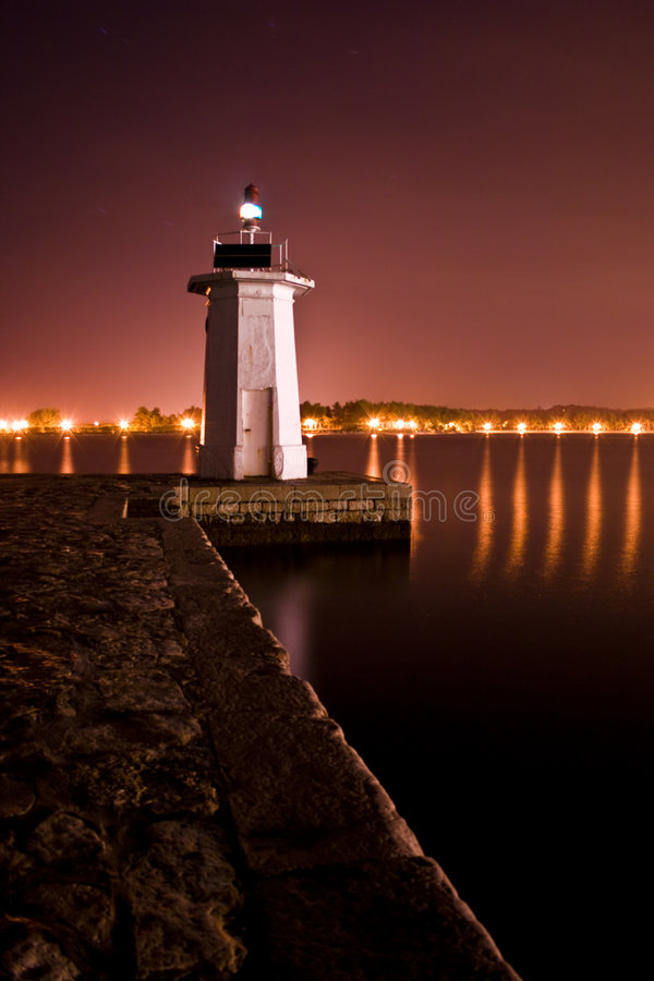 Lighthouse in the night royalty free stock photography