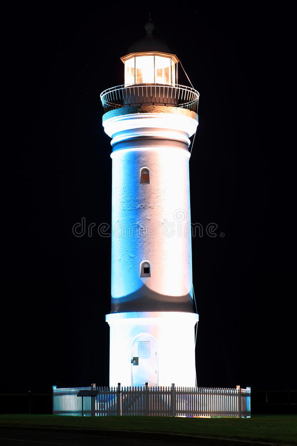 Lighthouse bright at night stock images
