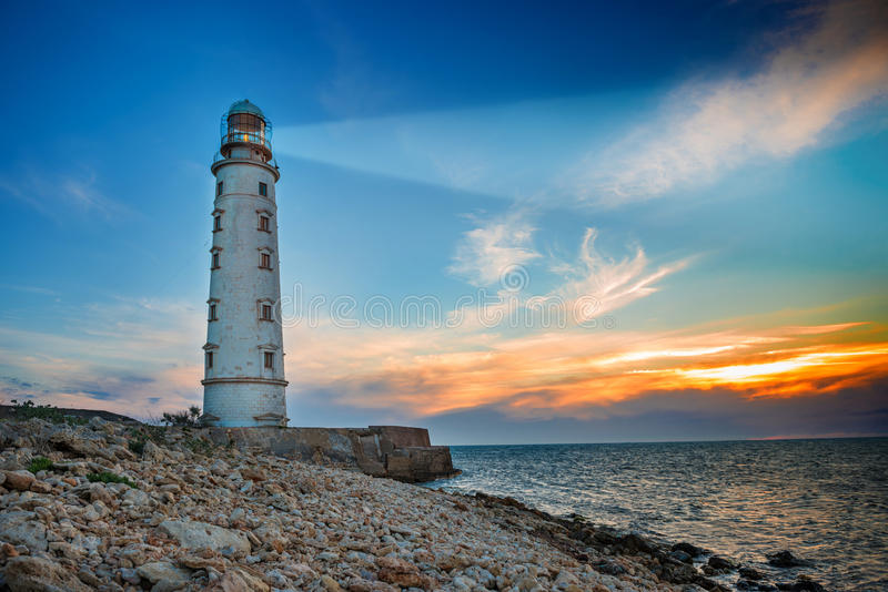 Lighthouse at night stock images