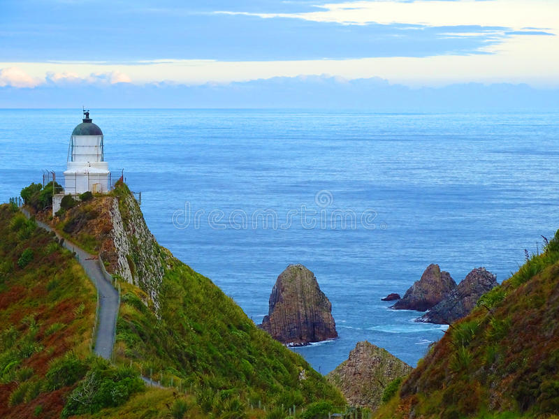 A lighthouse at Nugget Point, New Zealand stock image