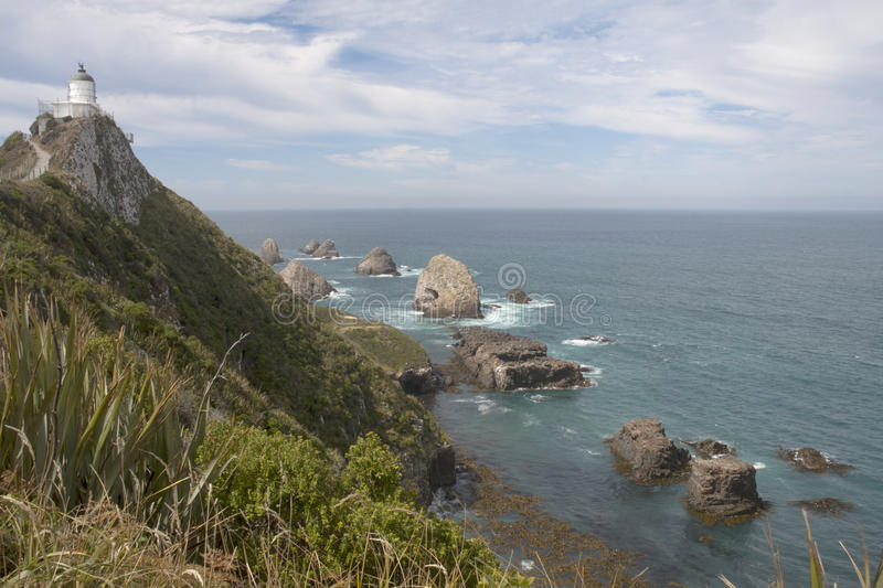 Download Lighthouse Overlooking Rocks Stock Photo - Image: 32350500