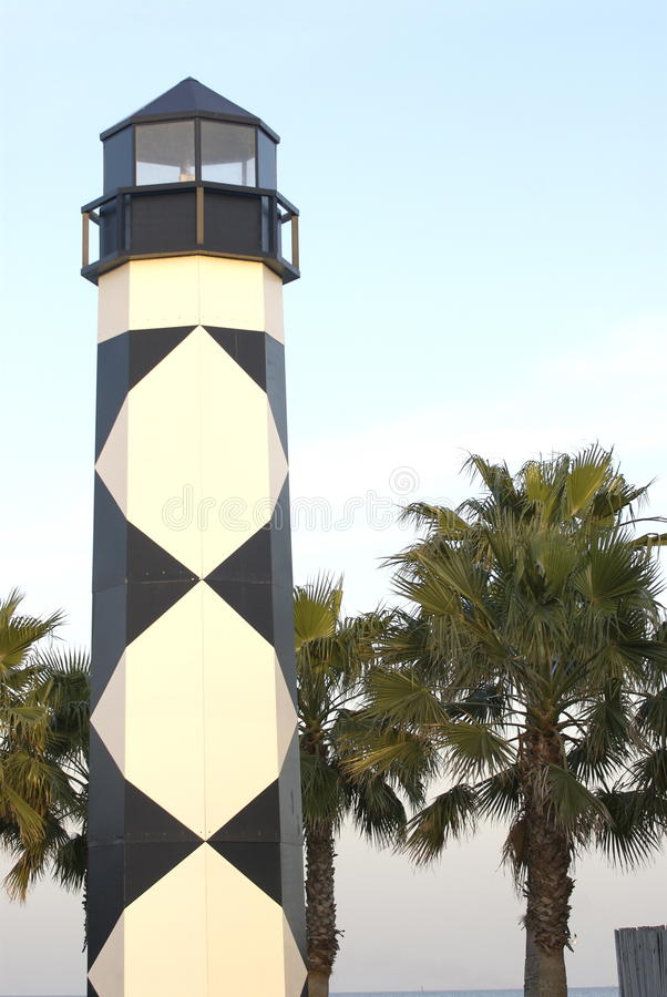 Lighthouse with palm trees royalty free stock photos