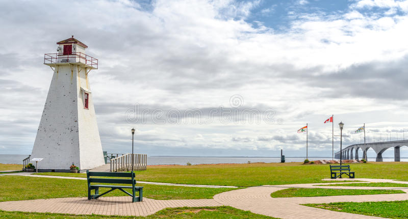 Lighthouse in the park. Warm muggy day in PEI. New Brunswick Confederation Bridge in distance. royalty free stock image