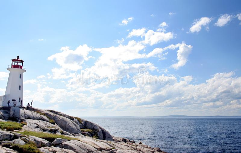 Lighthouse on Peggy`s Cove, Nova Scotia royalty free stock images