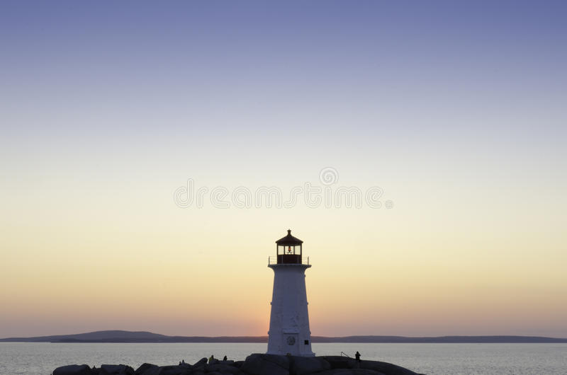 Download Lighthouse At Peggy's Cove, Nova Scotia At Sunset Stock Photo - Image: 26165320