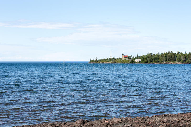 Lighthouse on a Peninsula in Lake Superior stock images