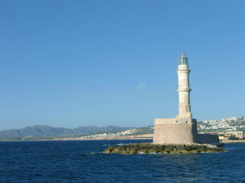 Lighthouse on pier stock photography