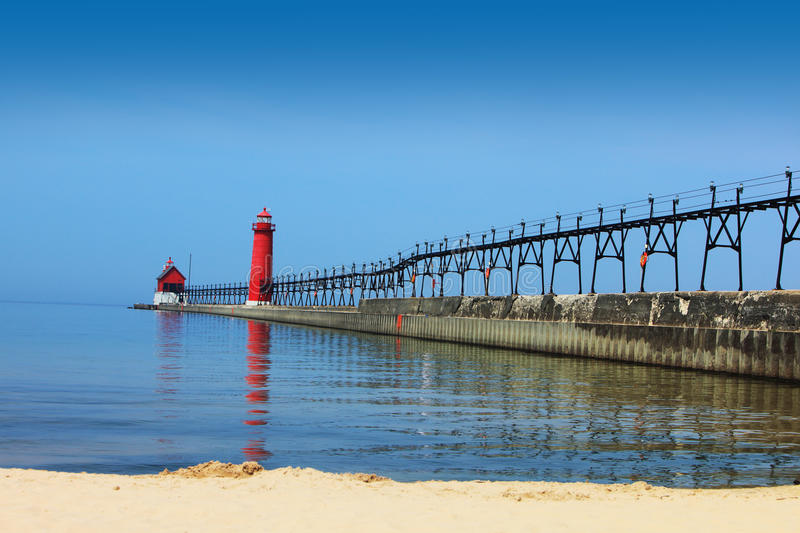Lighthouse And Pier Stock Photo