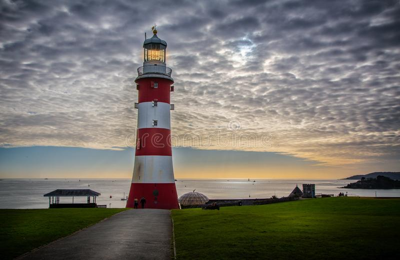 Lighthouse on Plymouth Hoe at sunset taken at Plymouth, Devon, UK. On 13 November 2017 stock image