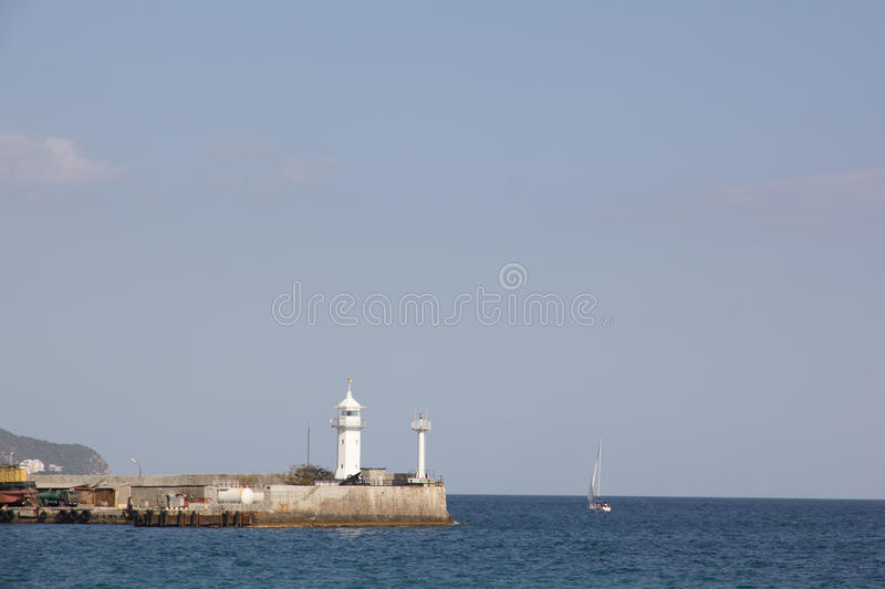 Lighthouse in the port. Yalta lighthouse in the port. Crimea. Ukraine stock photos