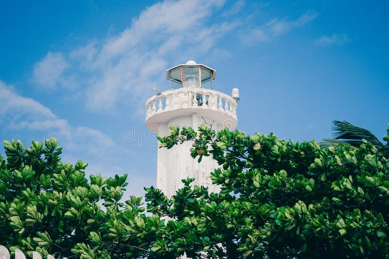 Lighthouse in Puerto Morelos, Quintana Roo, Mexico. Lighthouse with plants and trees in Puerto Morelos, Quintana Roo, Mexico stock image