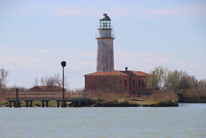 Lighthouse in the region Delta del Po, a natural paradise. Italy. Lighthouse in the region Delta del Po, a natural paradise. Here an arm of the Po river, Po di stock images