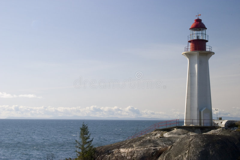 Lighthouse on a Rock 1 stock photos